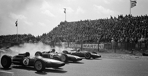 Start of the Dutch Grand Prix 1963: Smoking wheels in first row from later race winner Jim Clark (Lotus Climax 25, #6), Graham Hill (BRM P57, #12) and BrucPhoto © 2017 Rainer W. Schlegelmilch. All rights reservede McLaren (Cooper-Climax T66, #20)<br>